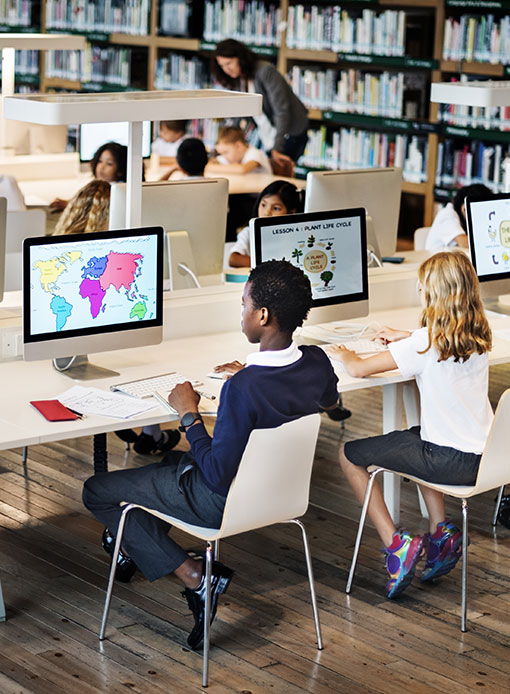 Kids on computers in library