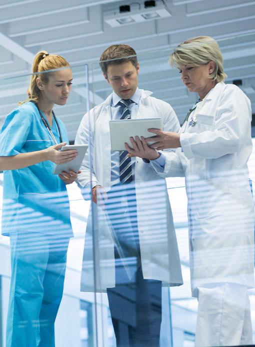 Doctors holding tablet